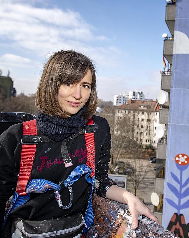 """Kate Voronina paints the """"Brave Wall"""" for Urban Nation and Amnesty International for International Women's Day,"""